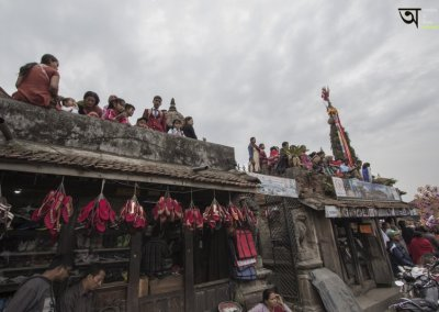 Onlookers at roof terrace watching Rato Machhendranath festival in Kathmandu Nepal . Pictures by pikturenama