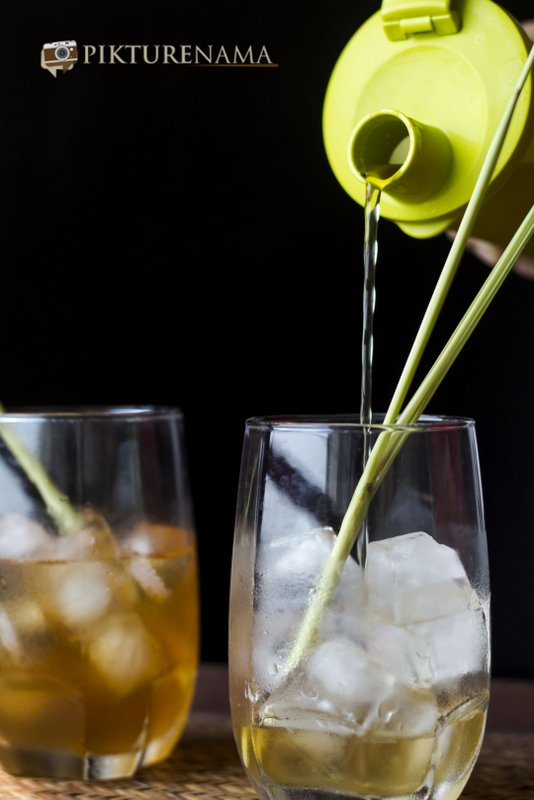 Iced tea with lemongrass and ginger on the rocks by pikturenama