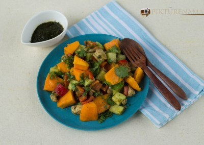 Mango Chicken salad with zesty coriander and chili dressing ready to be eaten