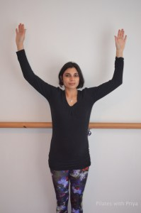 Pilates with Priya:  wall angels exercise 1