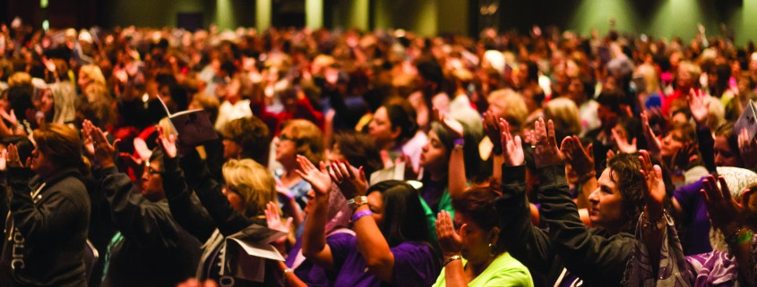 Conference participants pray together