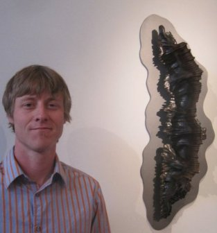 Luke Heimbigner and his sculpture