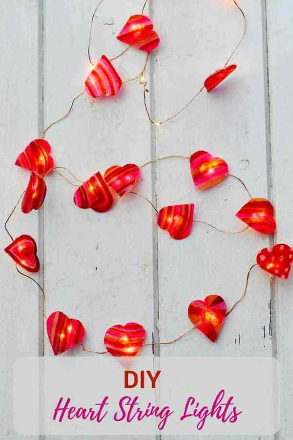 Use shrink plastic and sharpies to make some lovely Valentine's heart string lights to brighten up your home. #valentinesday #valentinescraft #stringlights #heartlights