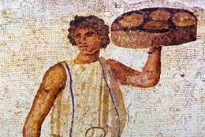 A servant of ancient Rome serving food on the table