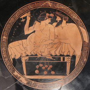 Vaso com figuras vermelhas vindo da Grécia Antiga que retrata uma prostituta com um cliente