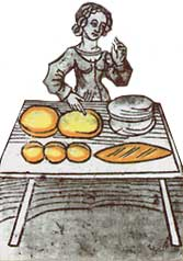 A woman kneads sweets. The crispy sweet is an ancient medieval still much appreciated