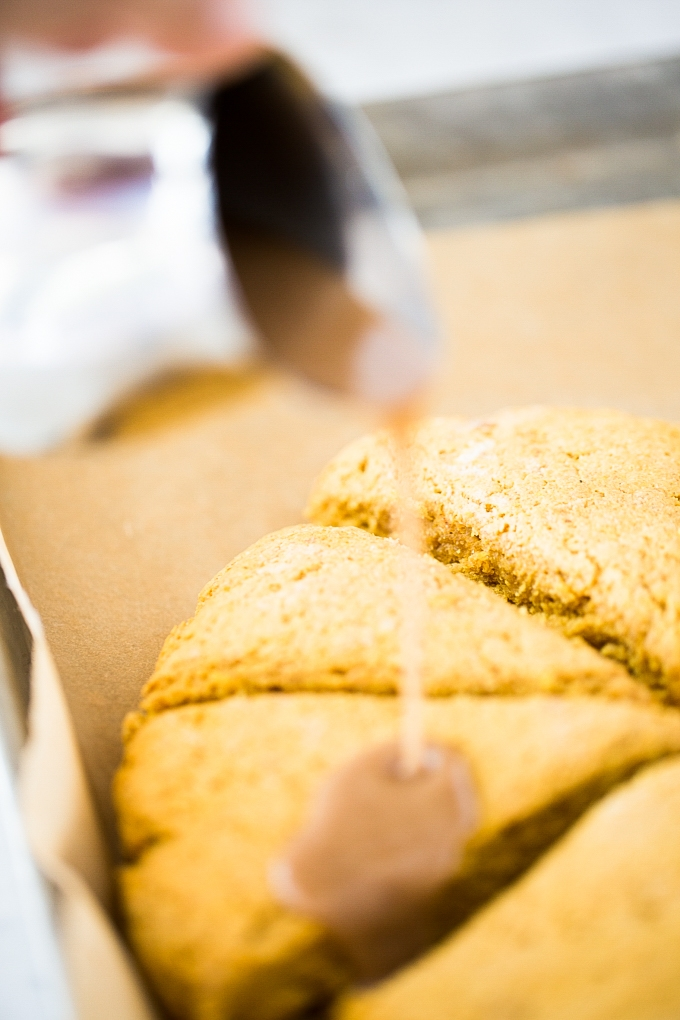 pouring glaze ove pumpkin scones