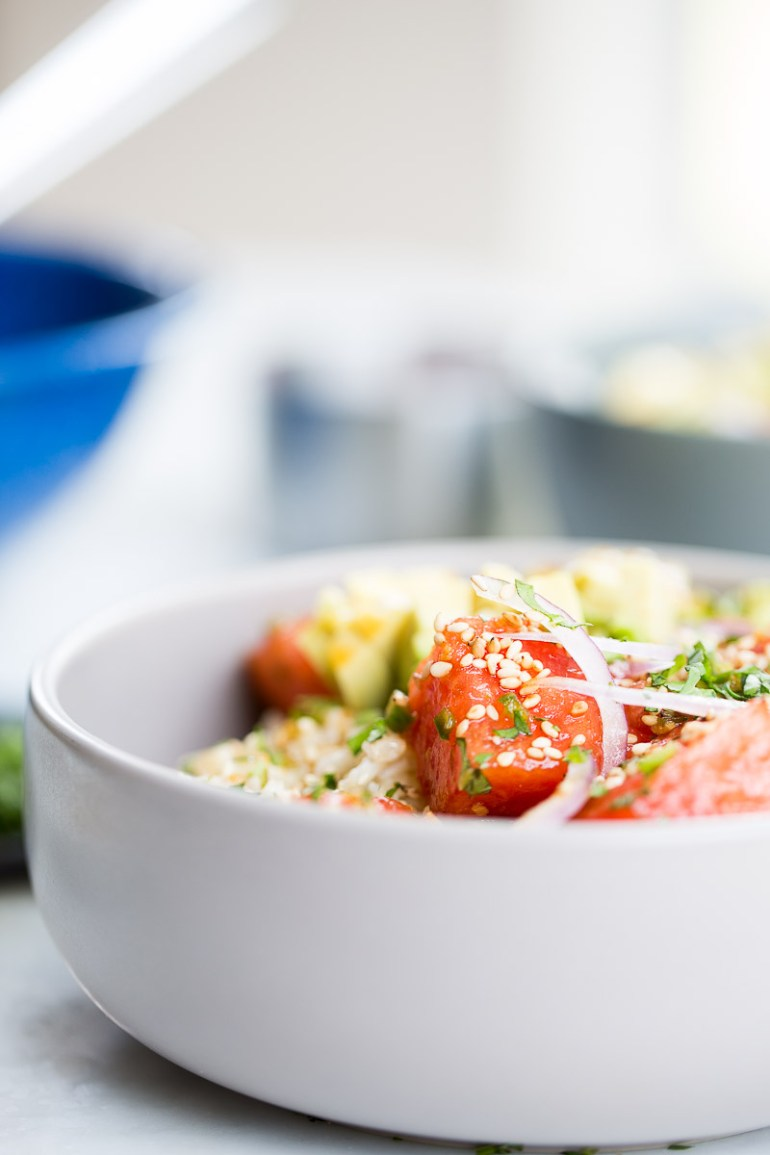 Vegan poke bowl. This poke bowl is made with rice, avocado, and watermelon.
