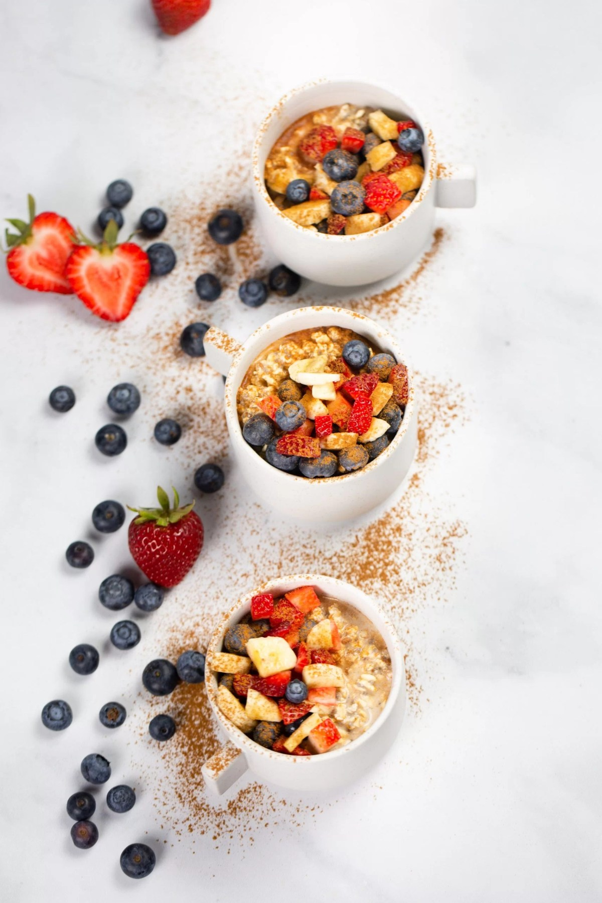 vegan oats for breakfast served with banana and berries.