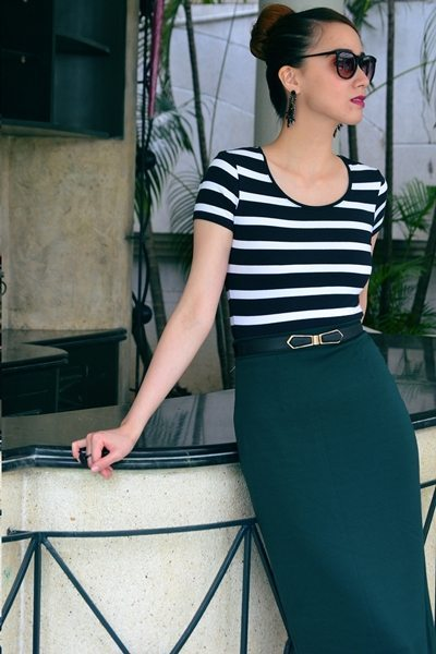 Bring edgy sophistication to work with an intense palette of black and white with hunter green.