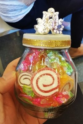 Special candy filled jars were given to kids as gifts to celebrate the occasion.