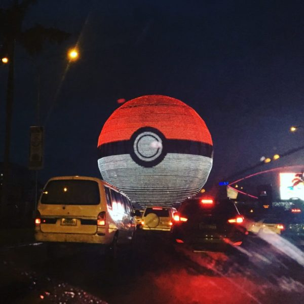 SM Mall of Asia's Globe transformed into a spinning Pokeball during the Nationwide Lure Party