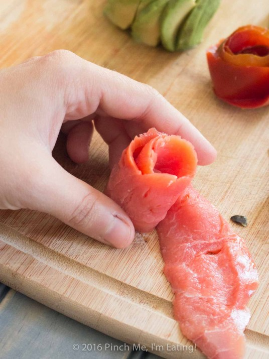 As beautiful as it is delicious, this surprisingly easy smoked salmon, tomato, and avocado rose salad showcases the uninhibited flavors of each ingredient, brightened with a splash of lemon. | www.pinchmeimeating.com
