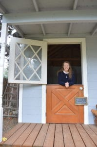 Janie standing in shed