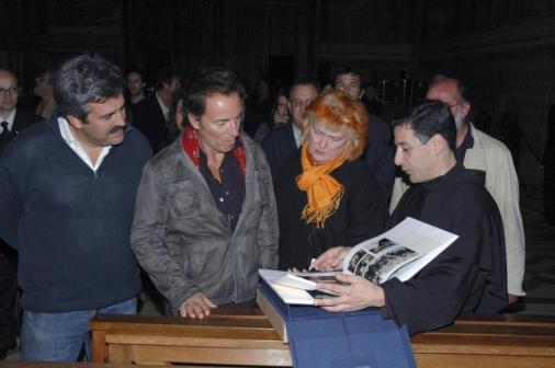 Rock star Bruce Springsteen is seen next to Father Enzo Fortunato during a visit to the Basilica of St. Francis in Assisi