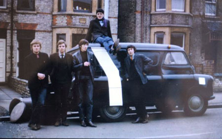 A picture of the band taken by Syd Barrett in 1966 featuring Bob Klose, left, Richard Wright, Roger Waters, centre, Chris Dennis, on top of the car, and Nick Mason.