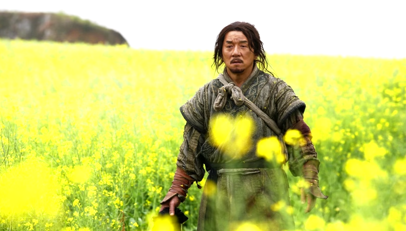 Image of Jackie Chan in a flower field, from the movie Little Big Soldier.