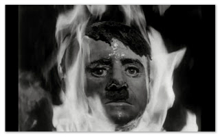 An image of Hitlers head on fire from the film They Saved Hitler's Brain