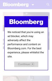"""Screenshot of a popup on Bloomberg.com that says """"We notcied that you're using an ad blocker, which may adversely affect the performance and content on Bloomberg.com. For the best experience, please whitelist the site."""""""