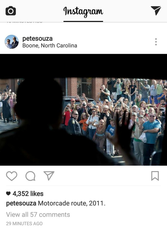 A Pete Souza photograph of a crowd cheering as Obama passes...