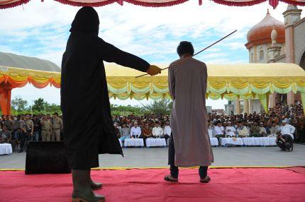 Indonesian men facing lashes