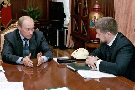"""ST.PETERSBURG, RUSSIAN FEDERATION: Russian President Vladimir Putin (L) speaks to Chechen Prime Minister Ramzan Kadyrov during their meeting at the Kremlin in Moscow, 05 May 2006. The pro-Russian prime minister of Chechnya, Ramzan Kadyrov, said 02 May that his militia, accused of conducting a reign of terror, was being reassigned and placed under Russian command. """"The structures no longer exist,"""" the Itar-Tass news agency cited Kadyrov as saying about transferring responsibility for the militia which until now was part of the Chechen anti-terrorist unit. AFP PHOTO / ITAR-TASS / PRESIDENTIAL PRESS SERVICE (Photo credit should read SERGEI ZHUKOV/AFP/Getty Images)"""