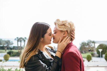 Lesbians sharing a kiss