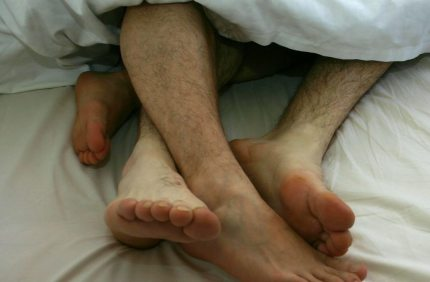 A gay couple in bed