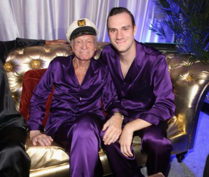 HOLMBY HILLS, CA - AUGUST 16:  Hugh Hefner (L) and Cooper Hefner attend the Annual Midsummer Night's Dream Party at the Playboy Mansion hosted by Hugh Hefner on August 16, 2014 in Holmby Hills, California.  (Photo by Christopher Polk/Getty Images for Playboy)