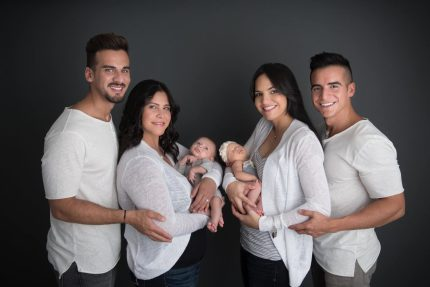 Mothers Mariely Martinez,left, and Carla Melendez, right with fathers Juny Roman and Alex Torres and newborns Marla and Matteo