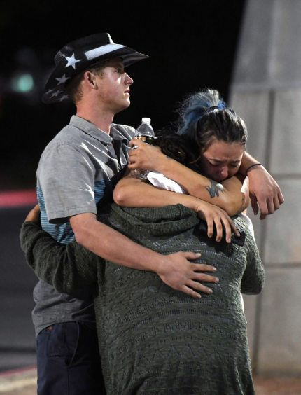LAS VEGAS, NV - OCTOBER 02: People hug and cry outside the Thomas & Mack Center after a mass shooting at the Route 91 Harvest country music festival on October 2, 2017 in Las Vegas, Nevada. A gunman, identified as Stephen Paddock, 64, of Mesquite, Nevada, allegedly opened fire from the Mandalay Bay Resort and Casino on the music festival, leaving at least 50 people dead and hundreds injured. Police have confirmed that one suspect has been shot. The investigation is ongoing. (Photo by Ethan Miller/Getty Images)