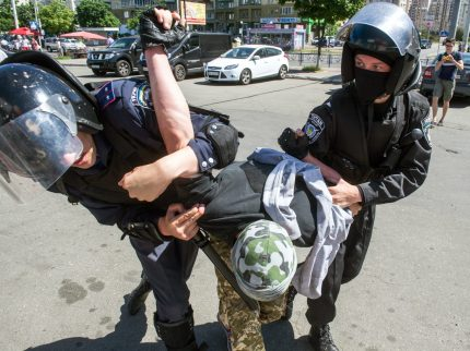 "Riot policemen arrest a right-wing activist during a protest against the first ""March of Equality"" parade in Kiev, since fighting with pro-Moscow rebels broke out in the east of the country last year, on June 6, 2015. At least seven people were injured and more than 20 arrested on June 6, 2015 in Kiev as scuffles broke out between members of a rare Ukrainian gay pride march and their nationalist opponents. AFP PHOTO / VOLODYMYR SHUVAYEV (Photo credit should read VOLODYMYR SHUVAYEV/AFP/Getty Images)"