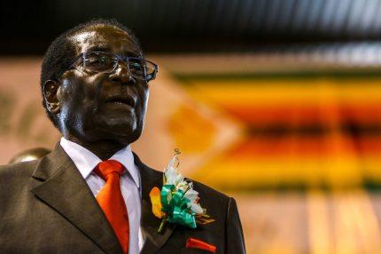 Zimbabwe President Robert Mugabe attends a meeting with the Zimbabwe National Liberation War Veterans Associatioin on April 7, 2016 in Harare. / AFP PHOTO / JEKESAI NJIKIZANA (Photo credit should read JEKESAI NJIKIZANA/AFP/Getty Images)