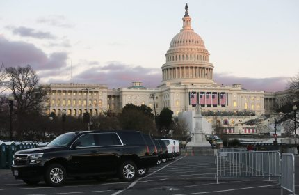 WASHINGTON, DC - JANUARY 18:  Vehicles are lined up in front of the U.S. Capitol building ahead of inauguration ceremonies for President-elect Donald Trump on January 18, 2017 in Washington, DC. Trump will be sworn in as the 45th U.S, president on January 20.  (Photo by Mario Tama/Getty Images)