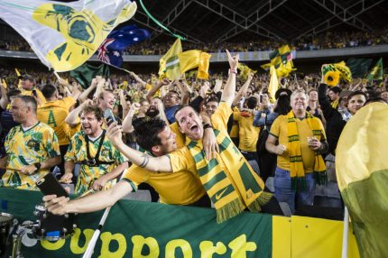 SYDNEY, AUSTRALIA - NOVEMBER 15: Socceroo fans celebrate after the teams win at the 2018 FIFA World Cup Qualifiers Leg 2 match between the Australian Socceroos and Honduras at ANZ Stadium on November 15, 2017 in Sydney, Australia. (Photo by Dominic Lorrimer/Getty Images)