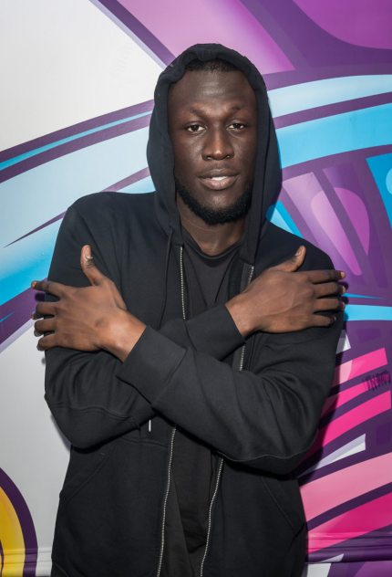 LONDON, ENGLAND - NOVEMBER 15: Stormzy poses for a photo during a visit to Kiss FM Studio's on November 15, 2017 in London, England. (Photo by Tim P. Whitby/Getty Images)