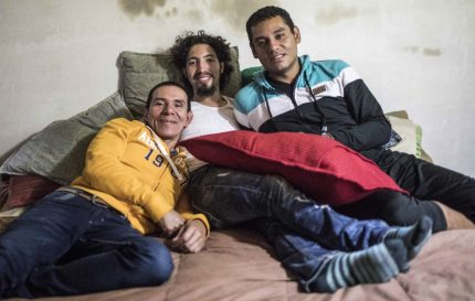 "Alejandro Rodriguez (L), Victor Prada (C) and Manuel Bermudez pose for a photo at their home in Medellin, Colombia on June 17, 2017. The three men have gained legal recognition as the first ""polyamorous family"" in the country , where same-sex marriages were legalized last year. / AFP PHOTO / JOAQUIN SARMIENTO (Photo credit should read JOAQUIN SARMIENTO/AFP/Getty Images)"