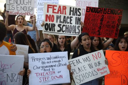 FORT LAUDERDALE, FL - FEBRUARY 17:  People join together after a school shooting that killed 17 to protest against guns on the steps of the Broward County Federal courthouse on February 17, 2018 in Fort Lauderdale, Florida. Earlier this week former student Nikolas Cruz opened fire with a AR15 rifle at the Marjory Stoneman Douglas High School killing 17 people.  (Photo by Joe Raedle/Getty Images)