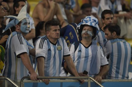 Argentinian supporters look on after their team's defeat in the final football match between Germany and Argentina for the FIFA World Cup at The Maracana Stadium in Rio de Janeiro on July 13, 2014. AFP PHOTO / JUAN MABROMATA (Photo credit should read JUAN MABROMATA/AFP/Getty Images)