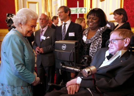 LONDON, UNITED KINGDOM - MAY 29: Queen Elizabeth II meets Professor Stephen Hawking (R) during a reception for Leonard Cheshire Disability in the State Rooms, St James's Palace on May 29, 2014 in London, England. (Photo by Jonathan Brady - Pool / Getty Images)