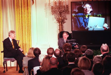 """WASHINGTON, : US President Bill Clinton (L) and Professor Stephen Hawking -- in person and on screen -- watch a scene from """"Star Trek the Next Generation"""", during a """"Millennium Evening"""" at the White House 06 March in Washington DC. Theoretical physicist Hawking talked about the future of science during the live telecast with the Clintons. AFP PHOTO Tim SLOAN (Photo credit should read TIM SLOAN/AFP/Getty Images)"""