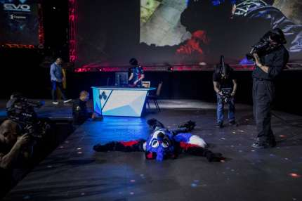 """LAS VEGAS, NV - AUGUST 05:  Dominique """"SonicFox"""" McLean celebrates after winning the DragonBall FighterZ Grand Championship during EVO 2018 at the Mandalay Bay Events Center on August 5, 2018 in Las Vegas, Nevada.  (Photo by Joe Buglewicz/Getty Images)"""