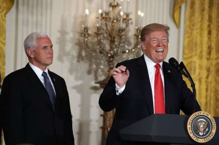 WASHINGTON, DC - JUNE 18:  U.S. President Donald Trump (R) speaks as Vice President Mike Pence (L) look on during a meeting of the National Space Council at the East Room of the White House June 18, 2018 in Washington, DC. It's the first time President Trump attended the public meeting of the council.  (Photo by Alex Wong/Getty Images)