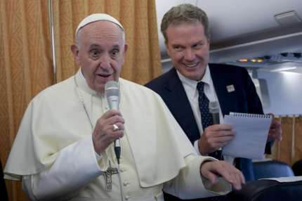 Pope Francis talks with journalists aboard a plane, at the end of his visit to Geneva on June 21, 2018, for the 70th anniversary of the World Council of Churches. - Pope Francis came at the invitation of the World Council of Churches (WCC), which was created in 1948 and groups 350 Protestant, Orthodox and Anglican churches from more than 100 countries around the world, with around half a billion believers among them. (Photo by Ciro FUSCO / POOL / AFP)        (Photo credit should read CIRO FUSCO/AFP/Getty Images)