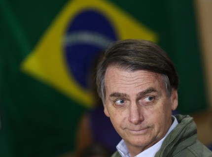 Jair Bolsonaro, far-right lawmaker and presidential candidate, casts his vote in October