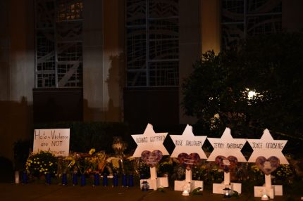 """The names of the victims are displayed at a memorial on October 28, 2018 outside the Tree of Life synagogue after a shooting there left 11 people dead in the Squirrel Hill neighborhood of Pittsburgh on October 27. - A man suspected of bursting into a Pittsburgh synagogue during a baby-naming ceremony and gunning down 11 people has been charged with murder, in the deadliest anti-Semitic attack in recent US history. The suspect -- identified as a 46-year-old Robert Bowers -- reportedly yelled """"All Jews must die"""" as he sprayed bullets into the Tree of Life synagogue during Sabbath services on Saturday before exchanging fire with police, in an attack that also wounded six people. (Photo by Brendan SMIALOWSKI / AFP) (Photo credit should read BRENDAN SMIALOWSKI/AFP/Getty Images)"""