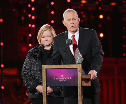 """NEW YORK, NY - JUNE 25: Judy Shepard and Dennis Shepard speak onstage at Logo's """"Trailblazer Honors"""" 2015 at the Cathedral of St. John the Divine on June 25, 2015 in New York City. (Photo by Neilson Barnard/Getty Images for Logo)"""