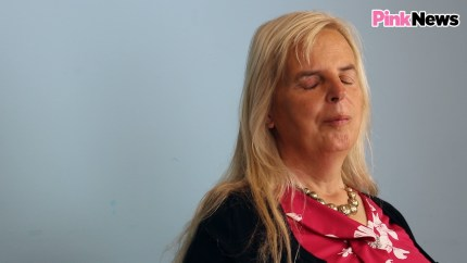 Trans woman Emily Brothers sits side on