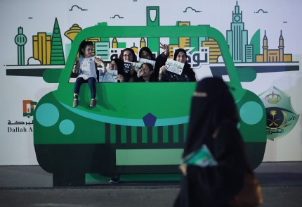 Teenage girls pictured in Saudi Arabia, where textbooks still promote violence against women, those engaging in gay sex, and religious minorities.