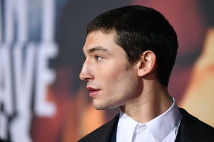Ezra Miller poses as he arrives for the world premiere of Warner Bros. Pictures film Justice League